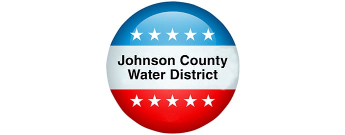 Red, white, and blue button with Johnson County Water District on it