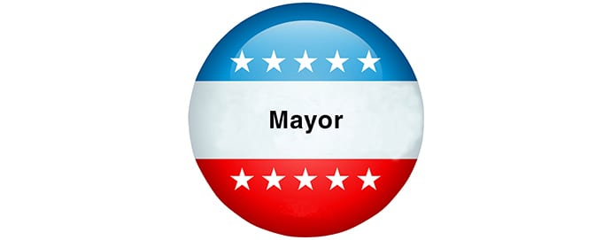 Red, white, and blue button with Mayor on it
