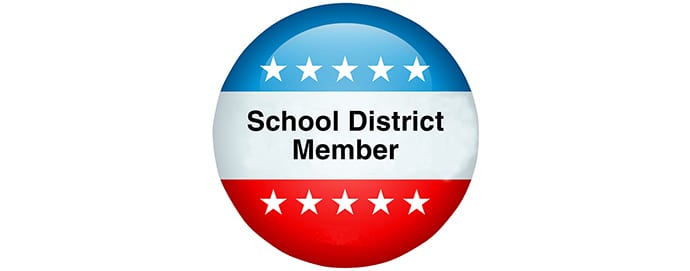 Red, white, and blue button with School District Member on it